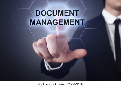 businessman clicks on virtual touchscreen display and select document management