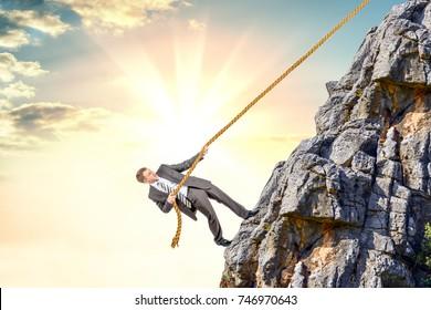 Businessman climb a mountain. Achievement business goal concept