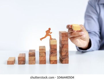 businessman climb up on stair to goal