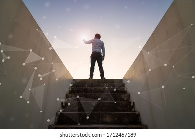 Businessman climbed on top of the stairs going to the city,  Ambitions concept and Success business with abstract network technology.