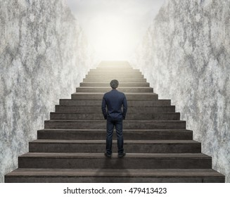 Businessman climbed on top of the stairs ,Success business and Ambitions concept