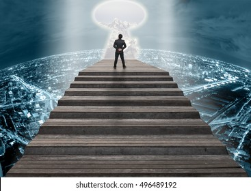 Businessman climbed on top of the stairs over the cityscape which can out of from the key door see view of mountains with snow and clouds,Success business and Ambitions concept