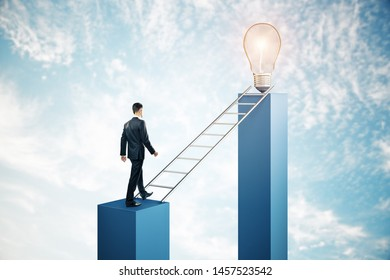 Businessman climbing abstract ladder to lamp on sky with clouds background. Leadership and idea concept