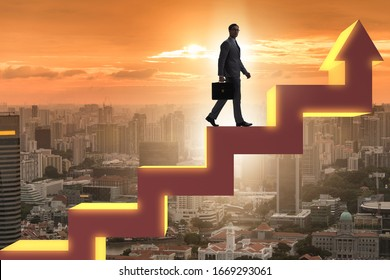 Businessman climbing bar charts in growth concept