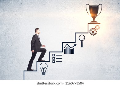 Businessman climbing creative steps and award sketch on concrete wall background. Success and leadership concept