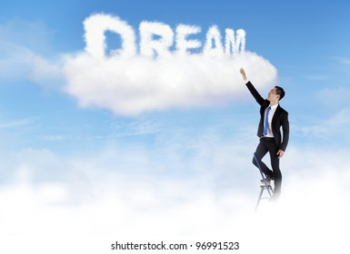 Businessman climbing ladder to fulfill his dream
