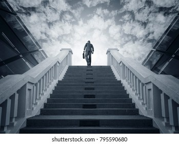 Businessman climbing stairs. Ambitions concept