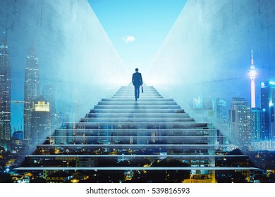 Businessman climbing stairs to get to a large city center. Concept of success . Double exposure,rear view,night scene .