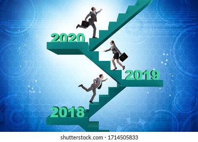 Businessman climbing stairs on yearly basis