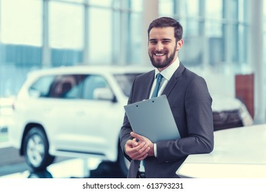 Businessman with clipboard indoors