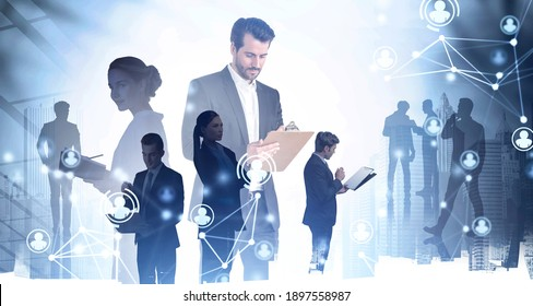 Businessman with clipboard standing in blurry city with double exposure of his team and network interface. Toned image