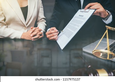 Businessman close up and Male lawyer or judge consult having team meeting with client, Law and Legal services concept,warm colours sun light.