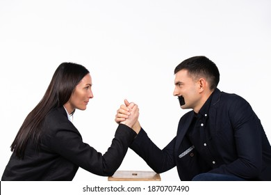 Businessman with closed mouth. The business woman wins in armwrestling. Gender neutral concept.