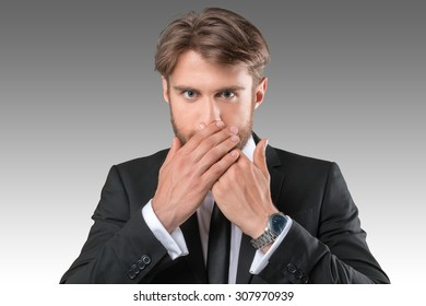 Businessman closing mouth with hands. Shut up
