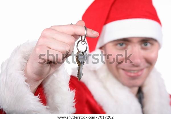 businessman clothed in costume of Santa holding keys