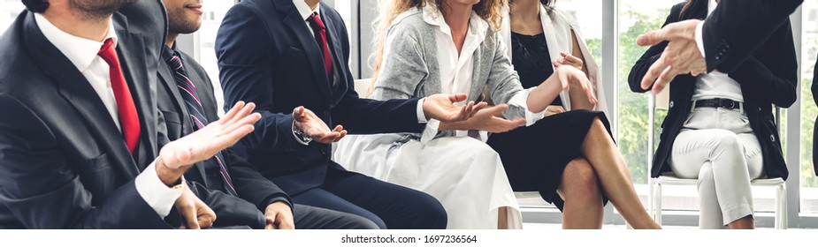 Businessman coach speaker presentation and discussing meeting strategy sharing ideas thoughts and conference seminar at hall or seminar room.presentation and coaching concept