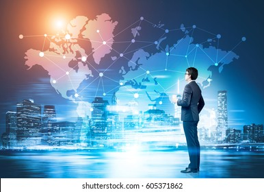 businessman with a coffee cup looking at a network sketch drawn on a world map on a glassboard