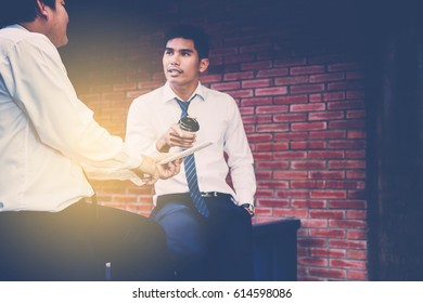 businessman with coffee cup relax with friend after meeting.
