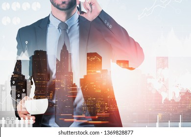 Businessman with coffee on phone with double exposure of modern city and global business infographics. Toned image. Elements of this image furnished by NASA