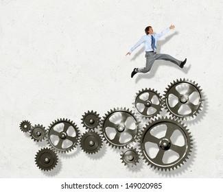 Businessman with cog wheel elements. Construction concept