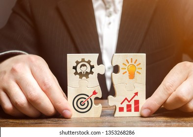 Businessman collects puzzles with the image of the attributes of doing business. Strategy planning concept. Organization of the process. Creating a business model. Management. Research, marketing.
