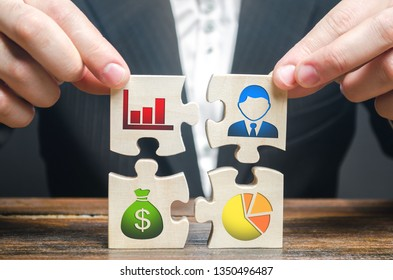 A businessman collects puzzles symbolizing individual elements and attributes of doing business. Organization of the process, the creation of a business model. Project management. Good planning,