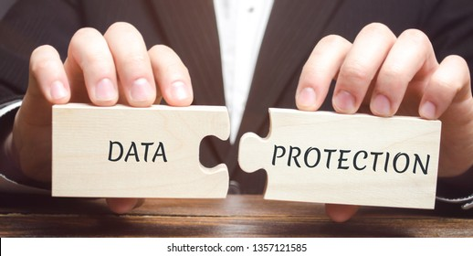 Businessman collects wooden puzzles with the word Data Protection. Denied access to confidential information. Ensuring the confidentiality of personal and business information. GDPR. Cyber Security