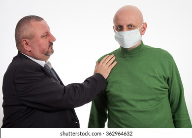 Businessman comforting young man suffering from cancer