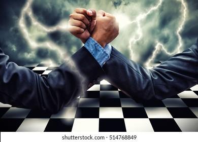 Businessman Competing In Arm Wrestling on lightning storm effect background