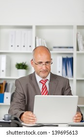 businessman concentrated on his laptop in the office