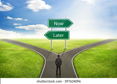 Businessman concept, Sign Now or Later road to the correct way.