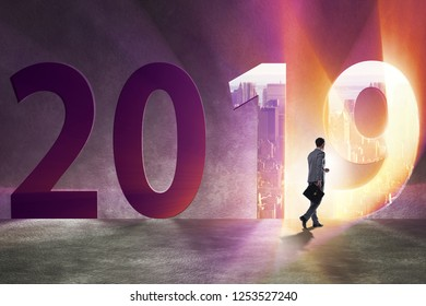 Businessman in the concept of transition to year 2019