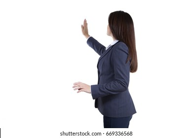 Businessman conducting a presentation, hand flipping an imaginary touch screen. Woman in business clothes. Introducing your ideas. Isolated on white background