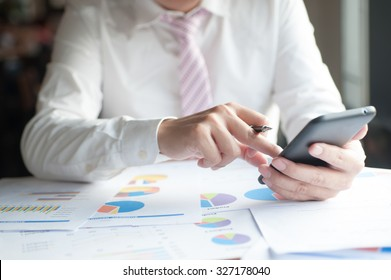 Businessman conference on mobile phone with modern devices, smart phone or mobile phone. Meeting for product and marketing to restructure,spreadsheet database financial Planning accounting of finance