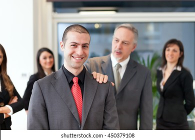 Businessman congratulating with an employee in his office