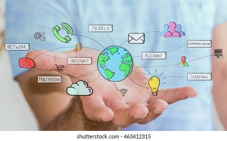 Businessman connecting hand drawn multimedia icons with his hand