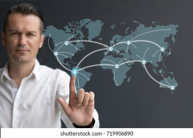 Businessman connecting worldwide social network scheme on digital display. Global communication network connection.
