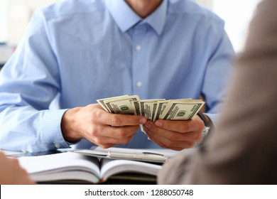 The businessman considers cash dollars in the office issues salaries to employees with black cash divides the profits as a result of illegal transactions everyone is happy