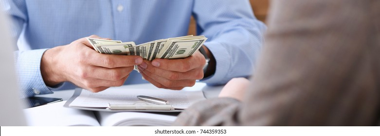 The businessman considers cash dollars in the office issues salaries to employees with black cash divides the profits as a result of illegal transactions everyone is happy.