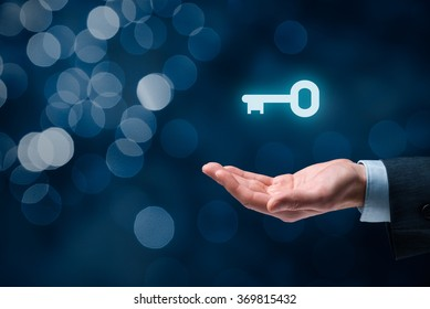 Businessman (consultant, coach, leader, CEO or another business person) offer key to success. Turnkey solution and services concept, bokeh in background.