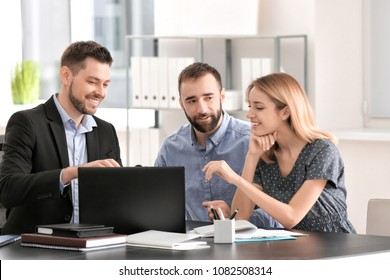 Businessman consulting young couple in office