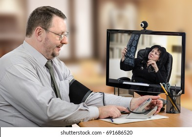 Businessman consults a telemedicine general practitioner at the first time. Mature man gets blood pressure in front of monitor with remote doctor carefully exams his brain x ray image. Horizontal shot
