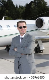 Businessman with corporate jet