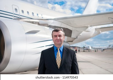 Businessman at Corporate Jet in the Airport