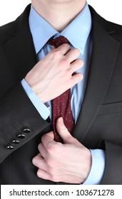 businessman correcting a tie close up