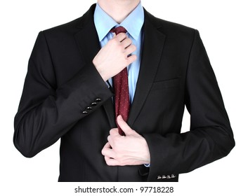 businessman correcting a tie close up