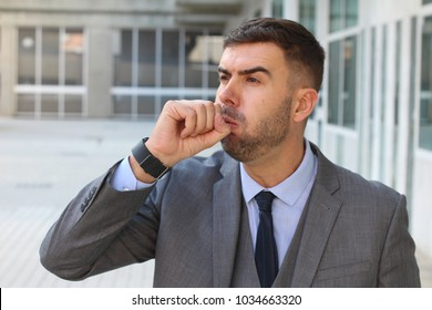 Businessman coughing in office space