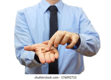 businessman counting coins on hand. Crisis concept