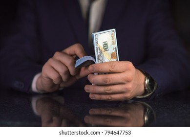 Businessman counting a lot of money. Successful business concept