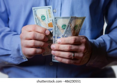 Businessman counting one hundred dollar bills. New 2013, US $100 Currency.
